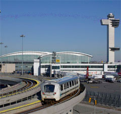 Photo of AirTrain JFK running on an elevated track at JFK
