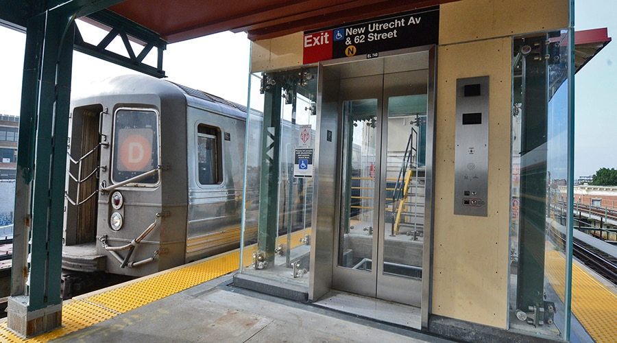 Elevator on a platform as a D train passes by