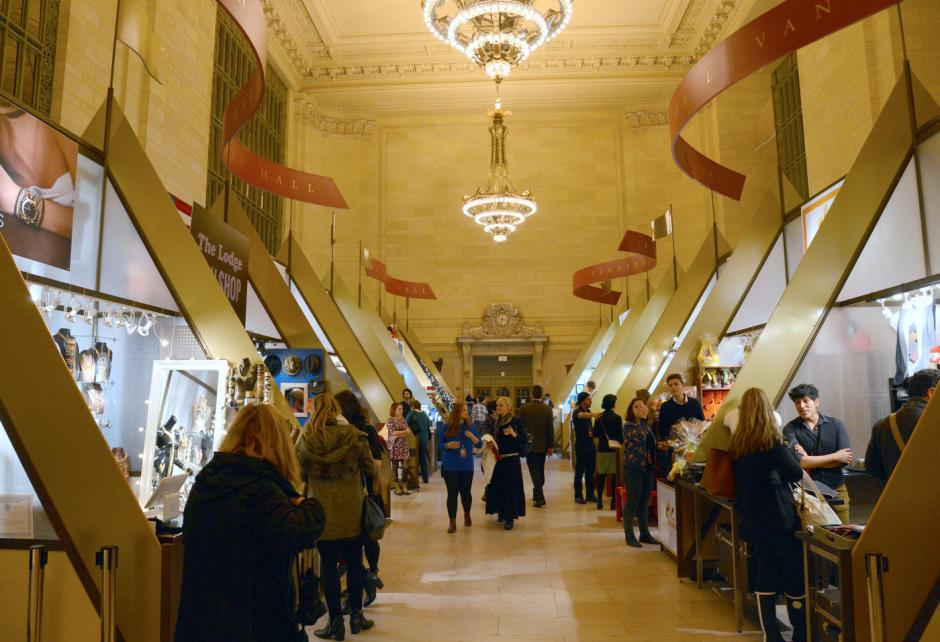 Shoppers walk through an indoor holiday market set up in Grand Central Terminal